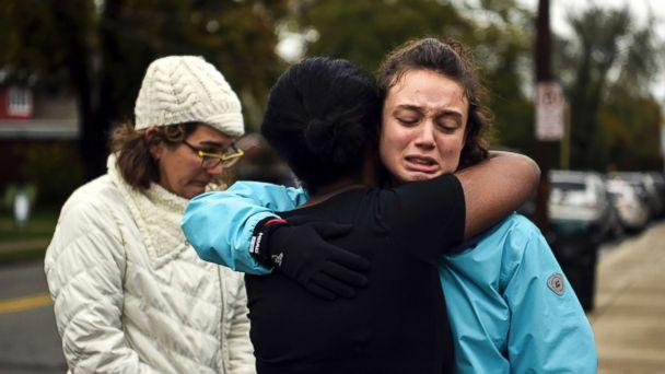 PHOTO: From left, Kate Rothstein looks on as Tammy Hepps hugs Simone Rothstein, after multiple people were shot at The Tree of Life Congregation synagogue, Oct, 27, 2018, in Pittsburgh. (Alexandra Wimley/Pittsburgh Post-Gazette via AP)