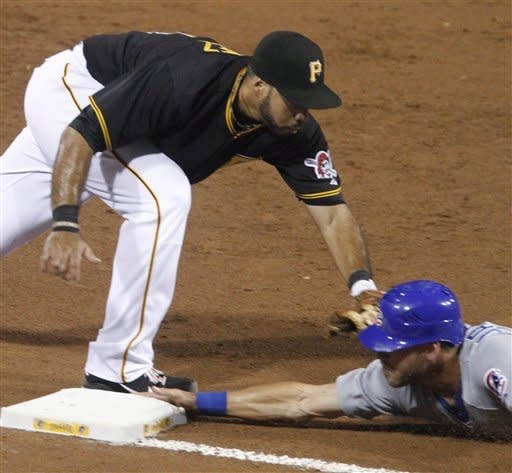 Pittsburgh Pirates third baseman Pedro Alvarez, left, tags Brett Jackson, who advanced on a ground ball by Darwin Barney in the sixth inning of a baseball game Friday, Sept. 7, 2012, in Pittsburgh. (AP Photo/Keith Srakocic)