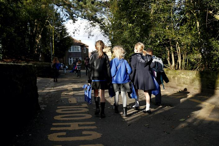 Children walk home from Altrincham C.E. aided primary school after the government's policy to close all schools from today due to the coronavirus pandemic on March 20, 2020 in Altrincham, United Kingdom: Clive Brunskill/Getty Images