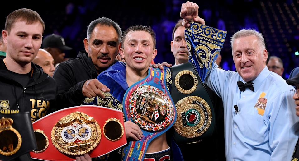 Gennady Golovkin poses with his belts after a second round knockout win over Vanes Martirosyan at StubHub Center on May 5, 2018 in Carson, California. (Getty Images)