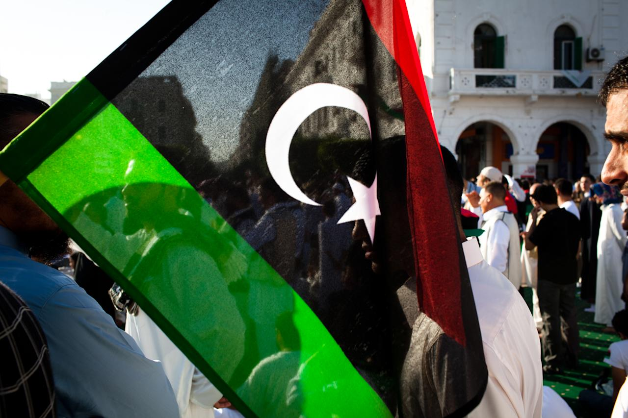 TRIPOLI, LIBYA - AUGUST 31: People gather at Martyr Square formerly known as Green Square, for the Eid Al-Fitr prayer on August 31, 2011 in Tripoli, Libya. Libyans celebrated the first Eid Al-Fitr in 42 years under a new regime. (Photo by Daniel Berehulak/Getty Images)