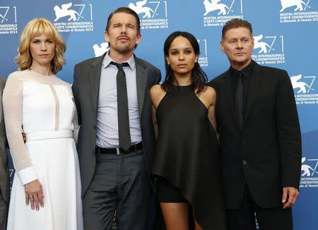 """Director Niccol poses with cast members during the photo call for the movie """"Good Kill""""at the 71st Venice Film Festival"""