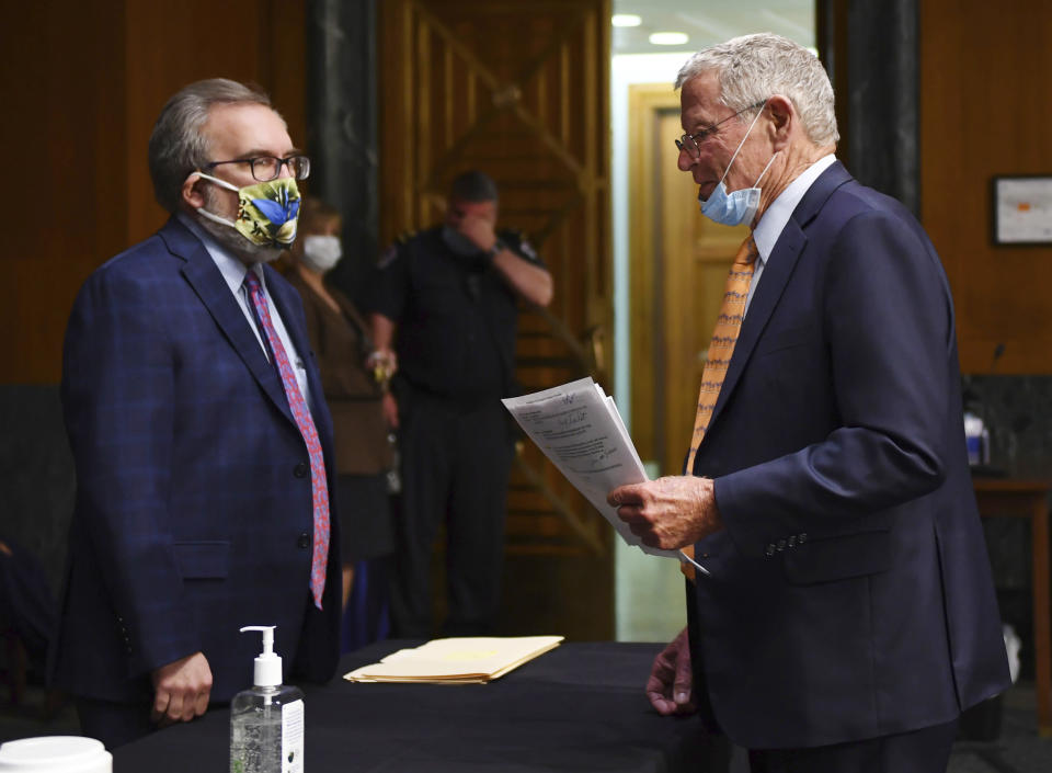 EPA Administrator Andrew Wheeler, left, speaks with Sen. James Inhofe, R-Okla., before opening remarks during a Senate Environment and Public Works Committee oversight hearing to examine the Environmental Protection Agency, Wednesday, May 20, 2020 on Capitol Hill in Washington. (Kevin Dietsch/Pool via AP)
