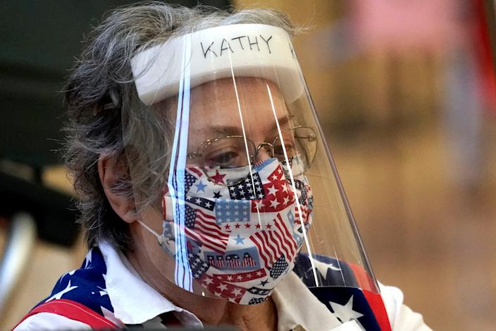 In Texas, Harris County election clerk Kathy Kellen wears a mask and face shield while working at a polling site on June 29, 2020, in Houston.