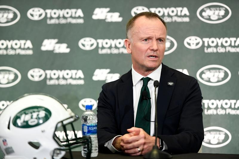 Jets owner Christopher Johnson with Jets helmet in front of him