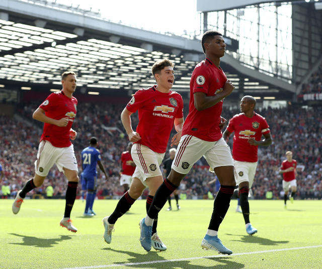 Manchester United's Marcus Rashford celebrates scoring his side's first goal of the game from the penalty spot during the English Premier League soccer match between Manchester United and Leicester City at Old Trafford Stadium, Manchester England. Saturday, Sept. 14 2019 (Martin Rickett/PA via AP)