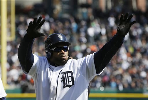 Detroit Tigers' Prince Fielder acknowledges the crowd after hitting a 3-run home run during the fifth inning of a baseball game against the New York Yankees in Detroit, Friday, April 5, 2013. (AP Photo/Carlos Osorio)