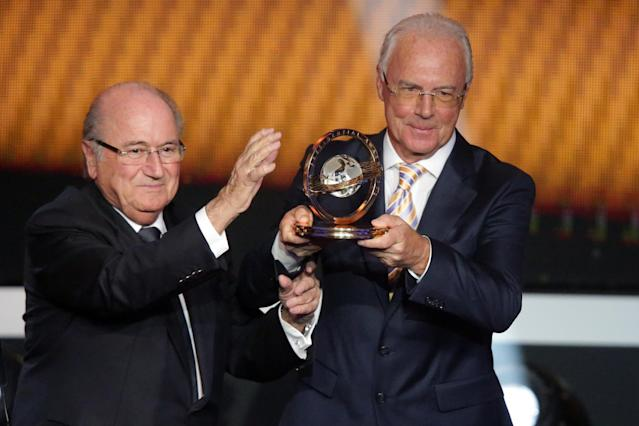 ZURICH, SWITZERLAND - JANUARY 07: Franz Beckenbauer receives the FIFA Presential award 2012 trophy by Joseph Blatter, FIFA president (L) at Congress House on January 7, 2013 in Zurich, Switzerland. (Photo by Christof Koepsel/Getty Images)