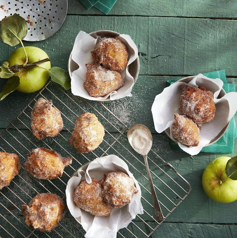 "<p>Tucked inside the brown sugar batter (spiked with fresh apple cider!) is a combo of chopped and grated Granny Smiths that add tons of texture and a tart edge to these sugar-dusted, shallow-fried apple fritters.</p><p><em><a href=""https://www.goodhousekeeping.com/food-recipes/dessert/a33655799/apple-fritter-recipe/"" rel=""nofollow noopener"" target=""_blank"" data-ylk=""slk:Get the recipe for Apple Fritters »"" class=""link rapid-noclick-resp"">Get the recipe for Apple Fritters »</a></em> </p>"