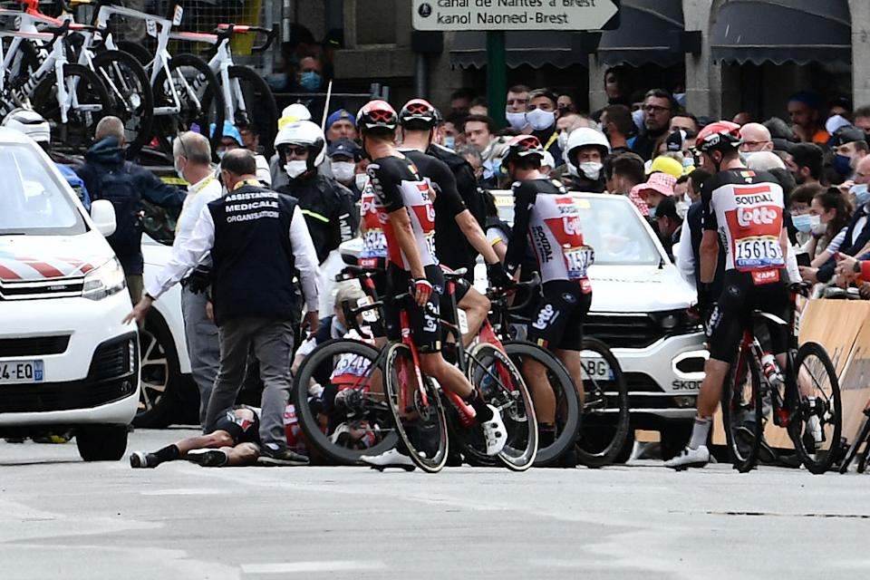 Caleb Ewan's Lotto teammates gather around him after his crash during the final spring on stage three of the Tour de France. (Photo by PHILIPPE LOPEZ/POOL/AFP via Getty Images)
