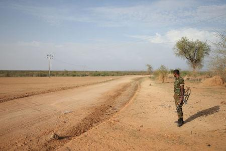 An Ethiopian military officer stands guard in the outskirts of Badme, a territorial dispute town between Eritrea and Ethiopia currently occupied by Ethiopia June 8, 2018. Picture taken June 8, 2018. REUTERS/Tiksa Negeri