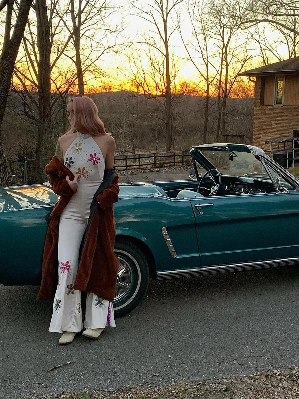 """<p>Ahhh, sunset in Nashville. This is one of my favorite vintage jumpsuits I've ever gotten from <a href=""""https://www.starstruckvintage.com/"""" rel=""""nofollow noopener"""" target=""""_blank"""" data-ylk=""""slk:Star Struck Vintage"""" class=""""link rapid-noclick-resp"""">Star Struck Vintage</a>, here in Nashville. The black flower jumpsuit I wore in another scene is from there too! Check them out!</p>"""