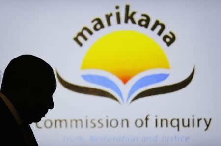 South African Deputy President Cyril Ramaphosa is silhouetted in the Farlam Commission, in Centurion
