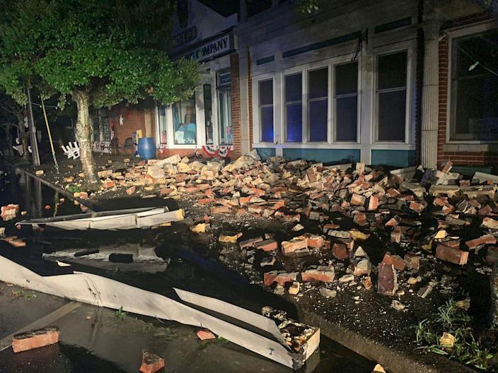 Debris covers the sidewalk in Southport, North Carolina, after Hurricane Isaias moved through the state, August 4, 2020.