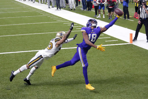 Minnesota Vikings wide receiver Justin Jefferson (18) tries in vain to pull in a pass over New Orleans Saints cornerback Marshon Lattimore in the end zone in the second half of an NFL football game in New Orleans, Friday, Dec. 25, 2020. The Saints won 52-33. (AP Photo/Brett Duke)