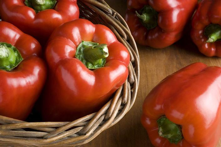 """<p>Red bell peppers help reduce high blood pressure with the help of potassium and <a href=""""https://www.prevention.com/food-nutrition/g21288692/vitamin-a-foods/"""" rel=""""nofollow noopener"""" target=""""_blank"""" data-ylk=""""slk:vitamin A"""" class=""""link rapid-noclick-resp"""">vitamin A</a>. They're also high in fiber and vitamin C, making it a healthy snack with hummus. </p><p><strong>Try it:</strong> If your peppers going bad in the fridge, broil them with some olive oil or add them to scrambled eggs or a <a href=""""https://www.prevention.com/food-nutrition/a22750128/chicken-and-broccoli/"""" rel=""""nofollow noopener"""" target=""""_blank"""" data-ylk=""""slk:stir-fry"""" class=""""link rapid-noclick-resp"""">stir-fry</a>.<br></p>"""