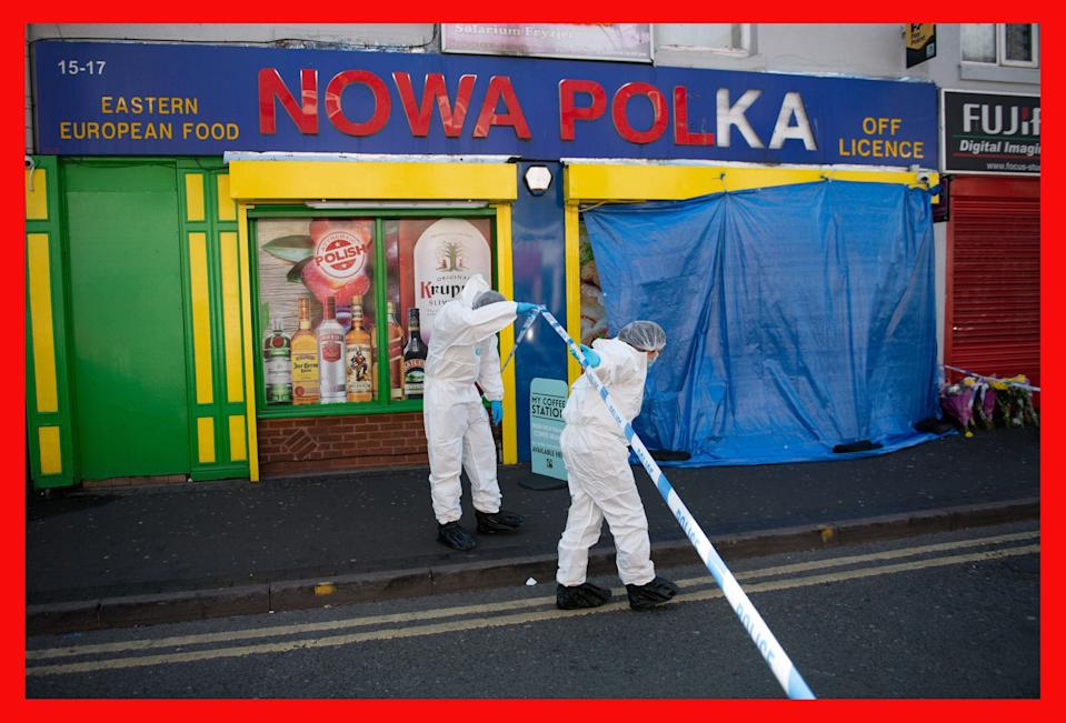 <p>Forensic officers enter a shop on Waterloo Road, Smethwick after a teenager was stabbed to death</p> (PA)