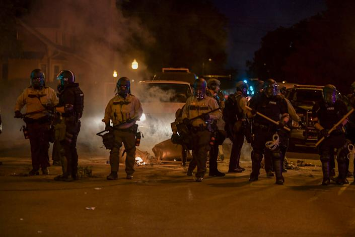 Police are seen armed with batons after protesters violated a curfew in effect in Minneapolis on Saturday. (Photo: Damairs Carter/MediaPunch/MediaPunch/IPx)