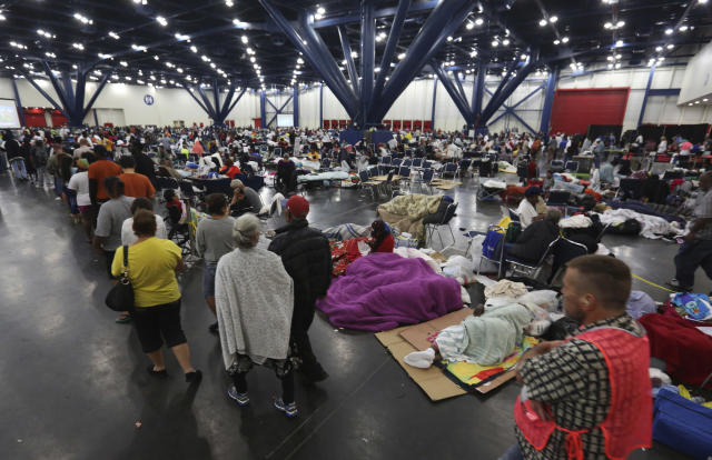 <p>People line up for food and others rest at the George R. Brown Convention Center that has been set up as a shelter for evacuees escaping the floodwaters from Tropical Storm Harvey in Houston, Texas, Tuesday, Aug. 29, 2017. (Photo: LM Otero/AP) </p>
