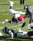 Rutgers running back Aaron Young (4) falls over Michigan State cornerback Chris Jackson (12) during the first half of an NCAA college football game, Saturday, Oct. 24, 2020, in East Lansing, Mich. (AP Photo/Carlos Osorio)
