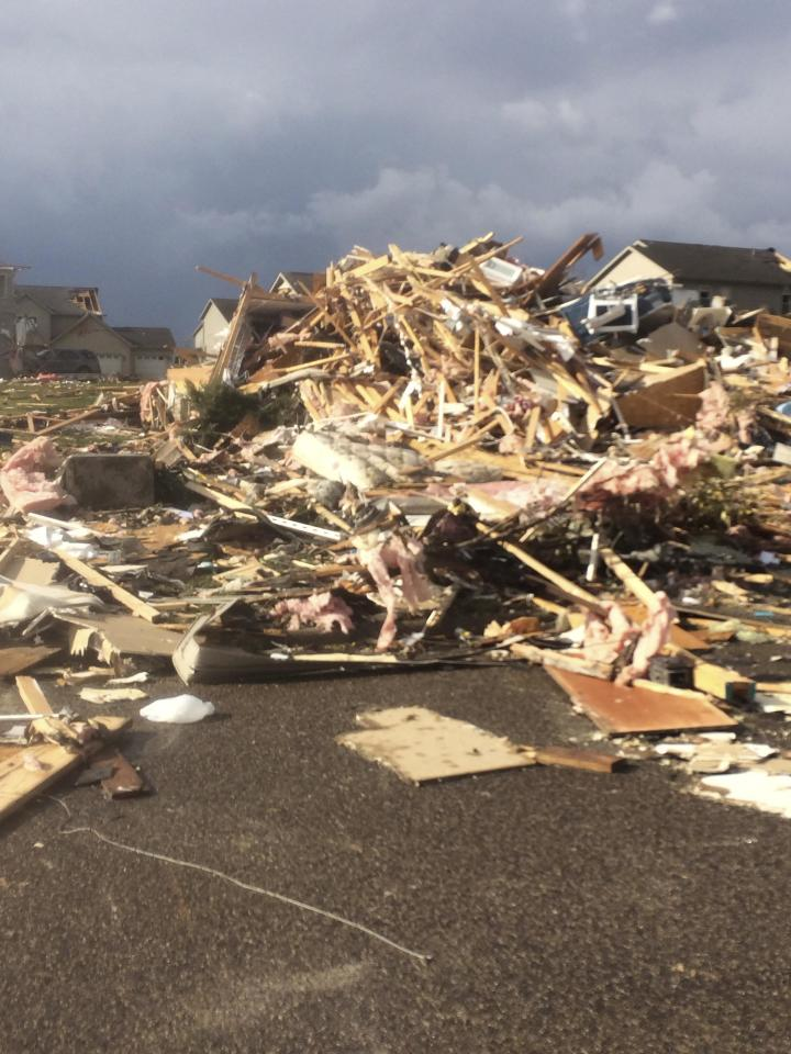 Extensive damage to homes is pictured in the aftermath of a tornado that touched down in Washington, Illinois