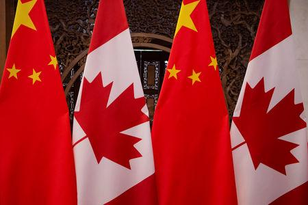 FILE PHOTO: Picture of Canadian and Chinese flags taken prior to the meeting with Canada's Prime Minister Justin Trudeau and China's President Xi Jinping at the Diaoyutai State Guesthouse