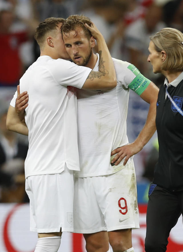 England's Eric Dier hugs with England's Harry Kane, right, during the semifinal match between Croatia and England at the 2018 soccer World Cup in the Luzhniki Stadium in Moscow, Russia, Wednesday, July 11, 2018. (AP Photo/Francisco Seco)