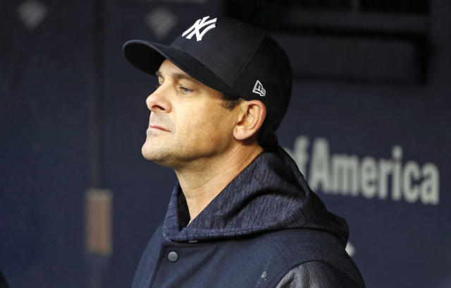 Yankees manager Aaron Boone opted against the comforts of home and slept at Yankee Stadium after Friday's game went into Saturday morning. (AP)