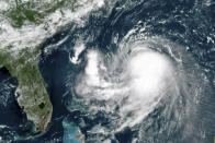 This OES-16 East GeoColor satellite image taken Friday, Aug. 20, 2021, at 11:40 a.m. EDT., and provided by NOAA, shows Tropical Storm Henri in the Atlantic Ocean. Henri was expected to intensify into a hurricane by Saturday, the U.S. National Hurricane Center said. Impacts could be felt in New England states by Sunday, including on Cape Cod, which is teeming with tens of thousands of summer tourists. (NOAA via AP)