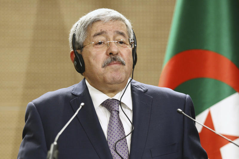 FILE - In this Sept. 17, 2018 file photo, former Algerian Prime Minister Ahmed Ouyahia listens to a question during a press conference in Algiers. Two former Algerian prime ministers have been convicted and sentenced to prison for corruption-related charges in a landmark trial. Ahmed Ouyahia was sentenced to 15 years in prison and $16,000 in fines. (AP Photo/Anis Belghoul, file)