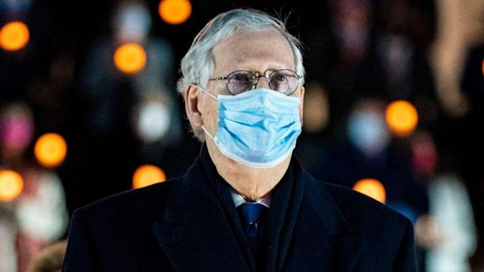 Senate Minority Leader Mitch McConnell joins fellow members of Congress to observe a moment of silence on the steps of the U.S. Capitol Tuesday night to mark the more than 500,000 U.S. deaths due to the COVID-19 pandemic. (Photo by Al Drago/Getty Images)