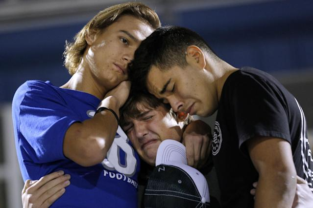 <p>Daniel Friesenhahn (C) is comforted by Derrick Barnhardt (R) and Chris Johnson during a vigil in the memory of those killed in the shooting at the First Baptist Church of Sutherland Springs in La Vernia, Texas, Nov. 7, 2017. (Photo: Jonathan Bachman/Reuters) </p>