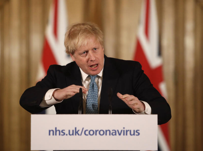 British Prime Minister Boris Johnson gestures as he gives a press conference about the ongoing situation with the COVID-19 coronavirus outbreak inside 10 Downing Street in London, Tuesday, March 17, 2020. For most people, the new coronavirus causes only mild or moderate symptoms, such as fever and cough. For some, especially older adults and people with existing health problems, it can cause more severe illness, including pneumonia. (AP Photo/Matt Dunham, Pool)