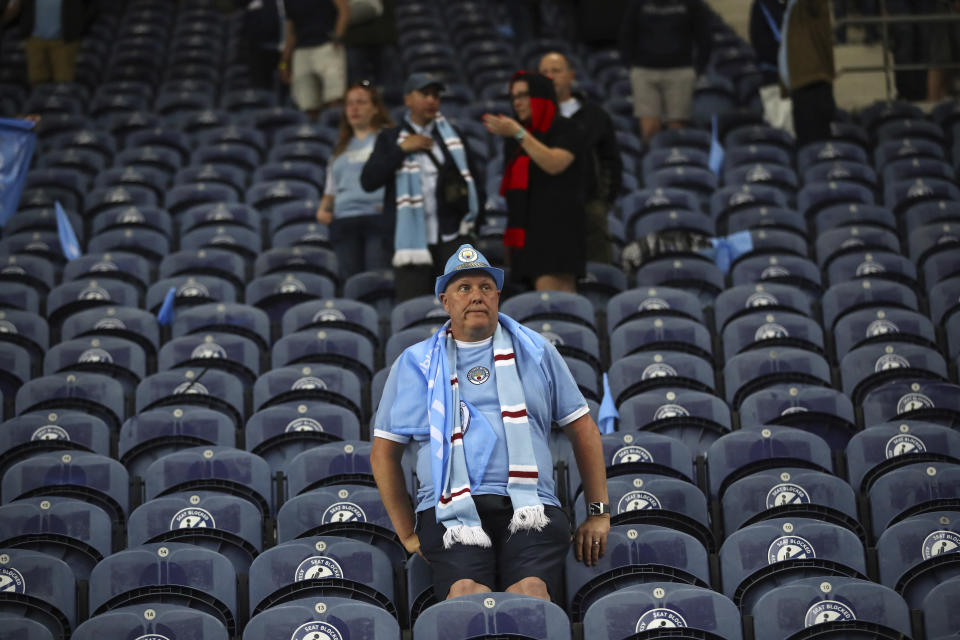 A Manchester City' supporter grimaces at the end of the Champions League final soccer match between Manchester City and Chelsea at the Dragao Stadium in Porto, Portugal, Saturday, May 29, 2021. (Carl Recine/Pool via AP)
