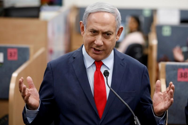 FILE PHOTO: Israeli Prime Minister Benjamin Netanyahu gestures as he delivers a statement during his visit at the Health Ministry national hotline, in Kiryat Malachi, Israel