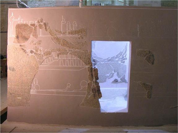 """This scene depicts hour five of the """"Amduat,"""" a book that also chronicles the sun god's journey at night. In this section he passes through the cavern of a god named Sokar. When re-assembling the box archaeologists had to temporarily leave an o"""