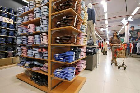 A customer walk inside a clothes store at a shopping mall in Kolkata,  June 20, 2018. Picture taken June 20, 2018.  REUTERS/Rupak De Chowdhuri