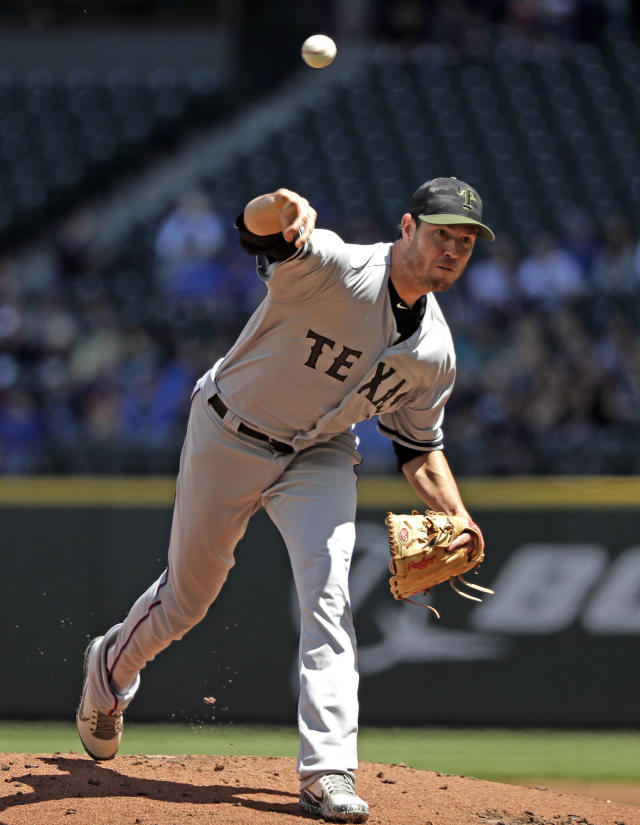 Texas Rangers starting pitcher Doug Fister throws against the Seattle Mariners in the first inning of a baseball game Monday, May 28, 2018, in Seattle. (AP Photo/Elaine Thompson)