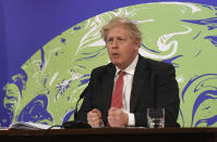 Britain's Prime Minister Boris Johnson speaks during the opening session of the virtual global Leaders Summit on Climate, as he sits in the Downing Street Briefing Room in central London, Thursday April 22, 2021. The virtual event attended by many national leaders from their countries, to raise global ambition on climate change is taking place on Earth Day, and hosted by US President Joe Biden. (Justin Tallis/Pool via AP)