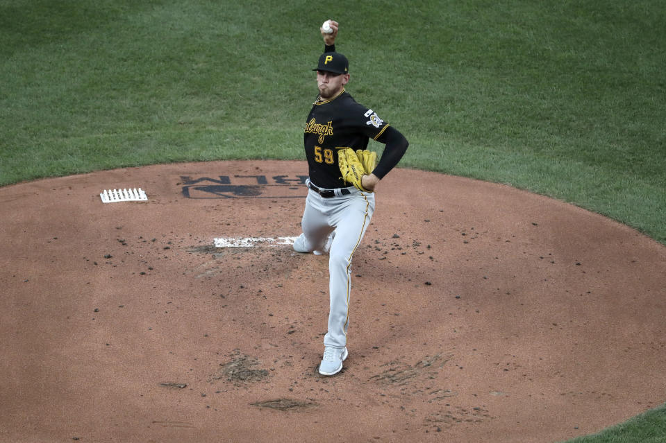 Pittsburgh Pirates starting pitcher Joe Musgrove throws during the first inning of a baseball game against the St. Louis Cardinals Friday, July 24, 2020, in St. Louis. (AP Photo/Jeff Roberson)
