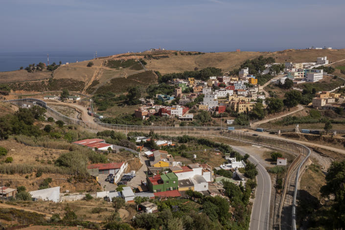 View of the border fence that separates Spain, left, and Morocco, right, as seen from the Spanish enclave of Ceuta, Thursday, June 3, 2021. (AP Photo/Bernat Armangue)
