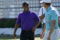 Harold Varner III chats with Jordan Spieth after finishing their third round of the Charles Schwab Challenge golf tournament at the Colonial Country Club in Fort Worth, Texas, Saturday, June 13, 2020. (AP Photo/David J. Phillip)