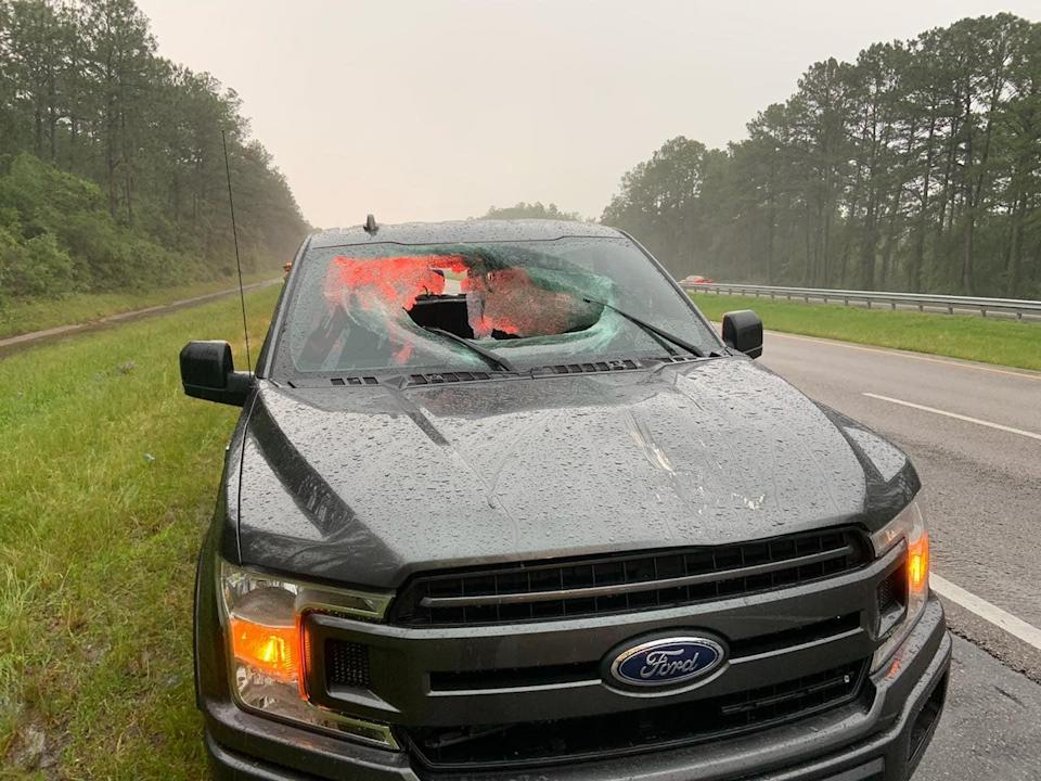 <p>A chunk of roadway smashed the windshield of a truck near Pensacola, Florida</p> (Walton County Fire Rescue)