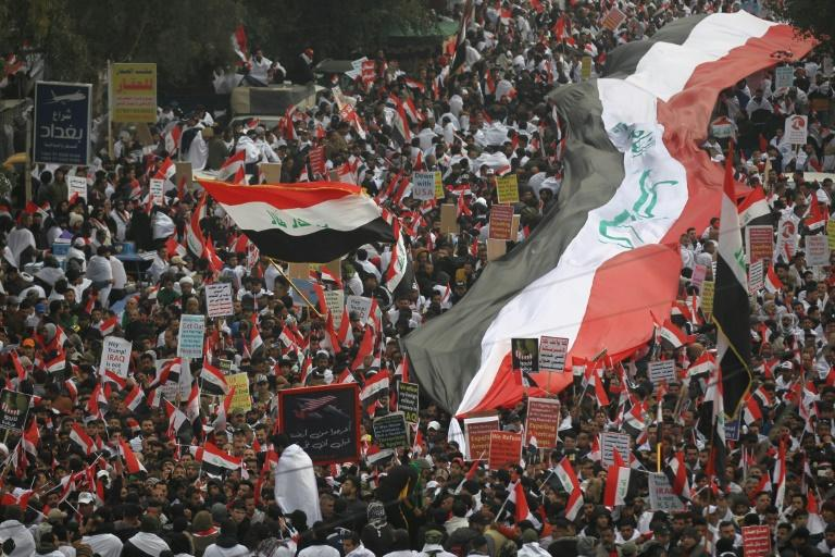 Thousands of Iraqi men, women and children of all ages massed in Baghdad to demand US troops leave the country