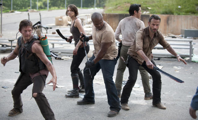 "Daryl Dixon (Norman Reedus), Maggie Greene (Lauren Cohan), T-Dog (Robert 'IronE' Singleton), Glenn (Steven Yeun) and Rick Grimes (Andrew Lincoln) in ""Seed,"" the Season Three premiere episode of ""The Walking Dead"" on AMC."