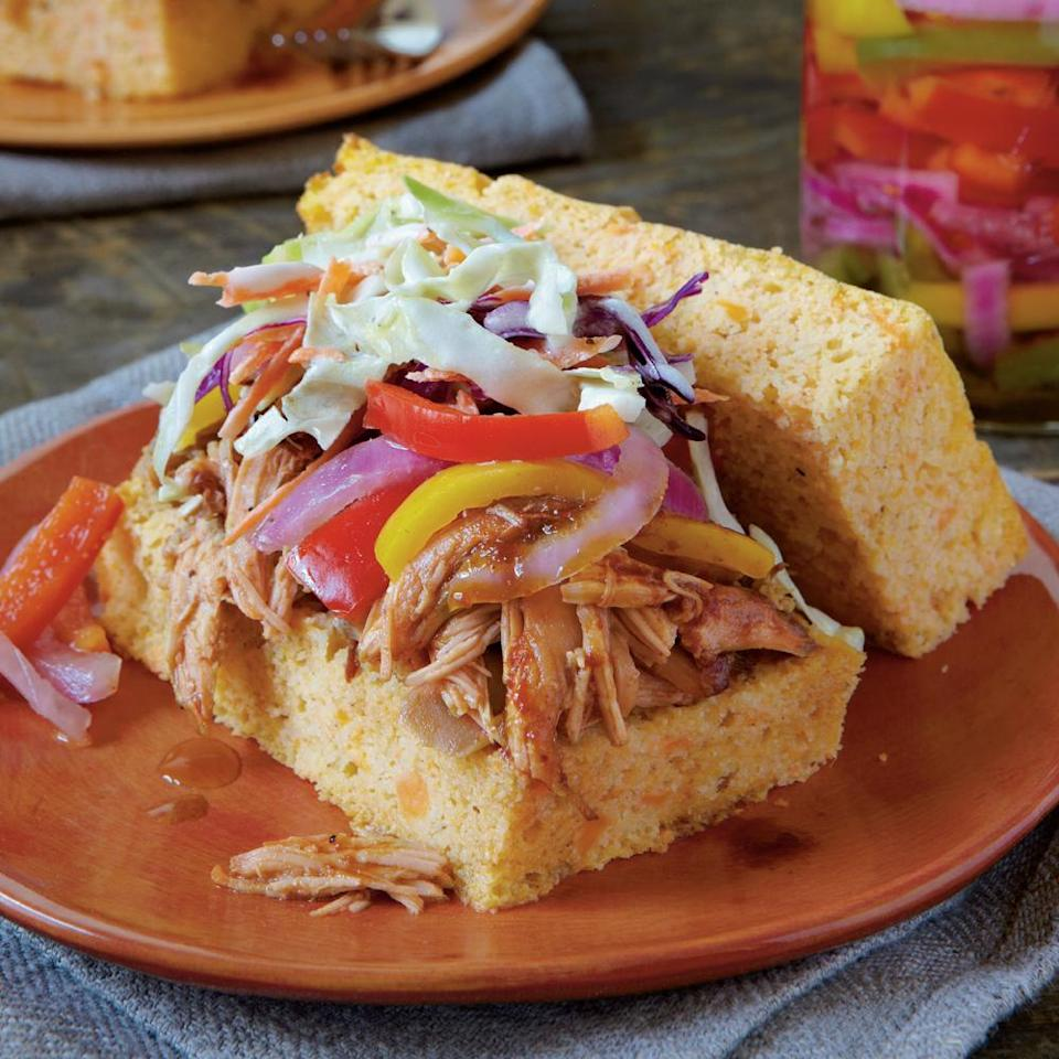 """<p><strong>Recipe: <a href=""""https://www.southernliving.com/syndication/slow-cooked-barbecued-sandwiches"""" rel=""""nofollow noopener"""" target=""""_blank"""" data-ylk=""""slk:Slow-Cooked Barbecued Chicken Sandwiches"""" class=""""link rapid-noclick-resp"""">Slow-Cooked Barbecued Chicken Sandwiches</a></strong></p> <p>After cooking low and slow, the chicken will fall right off the bone, shred easily, and be full of flavor. </p>"""
