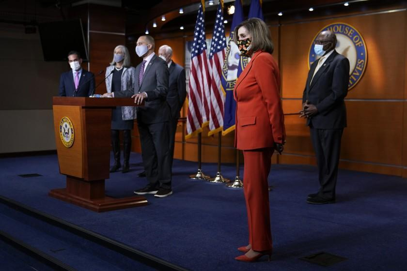 House Speaker Nancy Pelosi of Calif., second from right, listens to a reporter's question during a news conference before participating in the House Democratic Issues Conference on Capitol Hill in Washington, Tuesday, March 2, 2021. Standing with Pelosi are Rep. Pete Aguilar, D-Calif., Rep. Katherine Clark, D-Mass., Rep. Hakeem Jeffries, D-N.Y., House Majority Leader Steny Hoyer of Md., and House Majority Whip James Clyburn, of S.C. (AP Photo/Patrick Semansky)