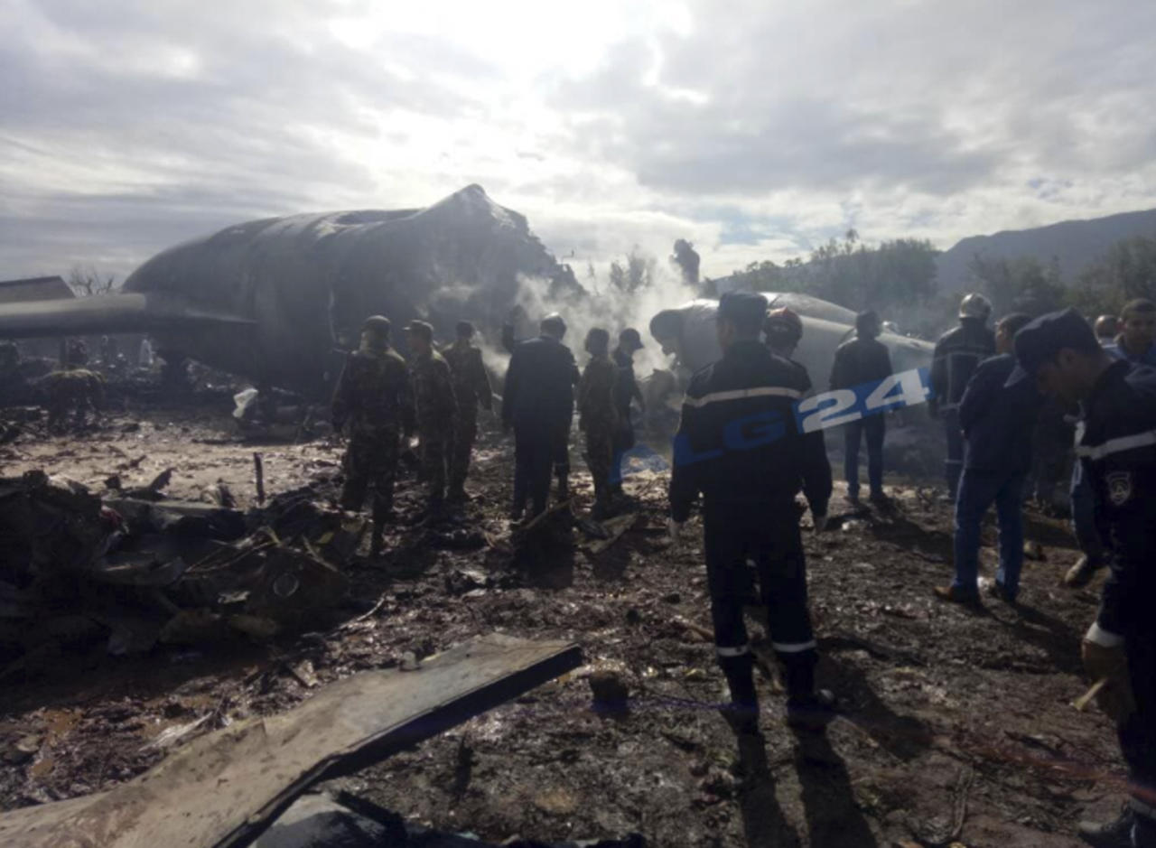 <p>This image dated April 11, 2018, and posted by Algerian news agency ALG24, shows firefighters and soldiers at the scene of a fatal military plane crash near Boufarik military base near the Algerian capital, Algiers. (Photo: ALG24 via AP) </p>