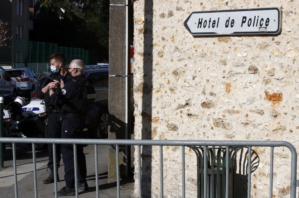 Police officers block the access next to the Police station in Rambouillet, south west of Paris, Friday, April 23, 2021. A French police officer was stabbed to death inside her police station Friday near the famed historic Rambouillet chateau, and her attacker was shot and killed by officers at the scene, authorities said. Police shot and killed the attacker at the scene, authorities said. The police officer was a 49-year-old administrative employee in the station, the spokesperson said. (AP Photo/Michel Euler)