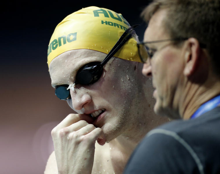 Australia's Mack Horton chats with a coach during a training session at the World Swimming Championships in Gwangju, South Korea, Saturday, July 20, 2019. (AP Photo/Lee Jin-man)